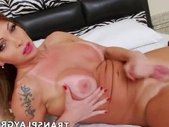 Charming Latina shemale Carla Novaes wanks massive her cock