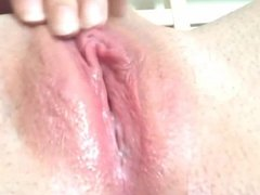 pink shaved creamy pussy close up