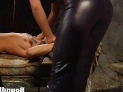 Slave tied up and whipped by ladies in latex