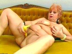 Granny masturbates with a banana