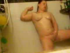 Chubby rubs herself to orgasm in shower