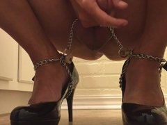 Shemale cums on black pumps chained to feet