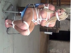 Plump MILF tied to a chair