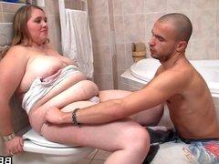 Big belly girlfriend is banged in the bathroom