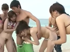 Japanese Gangbang at the beach