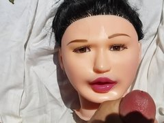 Cumming on dolls face