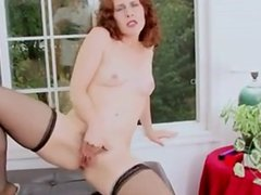 Hot redhead milf bates for the camera