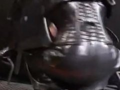 slave in rubber secured to the wall