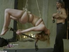 Suspended sex slave takes huge facial