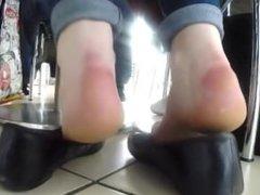 Beautiful but dirty bare feet dangling in flats