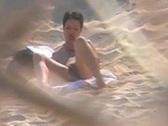 Voyeuring horny nudist girl fingering in public