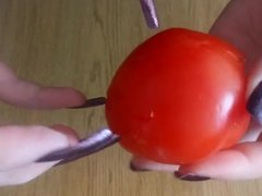 slicing tomato with nails