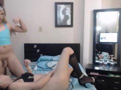 Two transsexual cuties fuck each other on cam