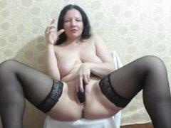 Brunette smokes and masturbates