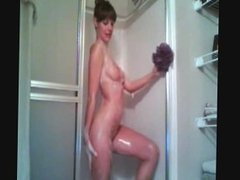 nerdy girl plays in the shower