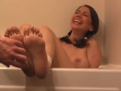 Viviana's feet tickled while she is in the bathtub