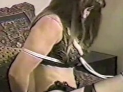 Snooping reporter in black lingerie tied on a bed