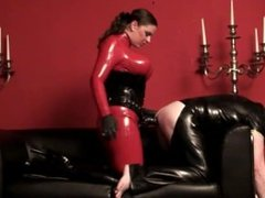 Latex Mistress fucks a male slave in the ass