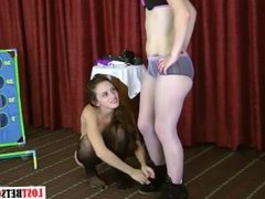 Two brunettes play a game of strip toss, loser faces consequences