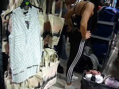 Two Sporty girls with BIG TITS trying on tops in shop