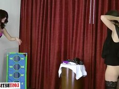 Two brunettes play a game of strip toss