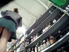 Lady upskirted in Liqueur shop with a little dance