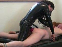 rubber Mistress strapon fuck slave in bondage with big strapon
