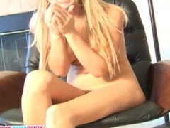Blondie teasing her pussy on office chair