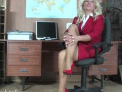 Blonde teases her pussy in the office