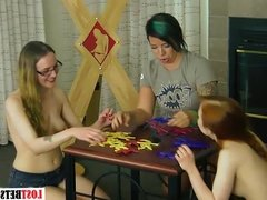 Three beautiful ladies play a strip balancing game