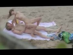Hot teen caught blowing and riding on the beach by a peeper