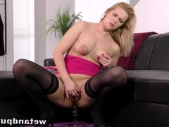 Blonde cutie plays with a nice glass dildo