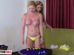 2 Busty blondes play a strip game of roll the dice