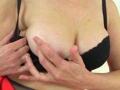 UK milf Ila Jane rips holes in her pantyhose