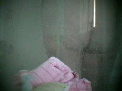 Visiting friend L showers hidden cam