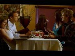 Footsie under table scene