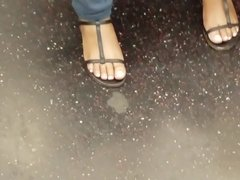 Candid ebony feet in sandals