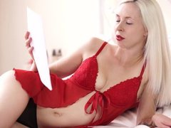 Slim tattooed blonde reads erotic fiction while stripping