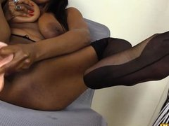 Black girl in nylons masturbates and shows footjob skills