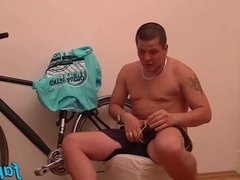 Horny dude Tomm plays with his dick after bicycle checking