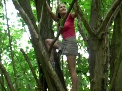 Beautiful blonde pees from a tree