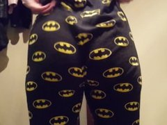She pulls up her tight batman leggings.