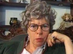 Granny with glasses masturbating.