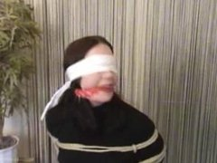 Chairtied and blindfolded