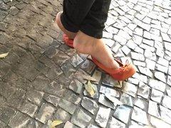 Candid girl feet in street