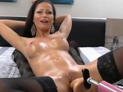 Hot cam girl using dildo machine and squirts