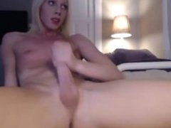 Blonde Shemale releases her jizz on her belly
