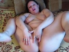 Naked milf shows his holes and masturbates them