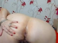 Blonde mature spreads her legs and ass cheeks on cam.