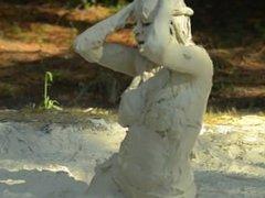 Bikini girl playing in mud